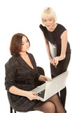 Two women sitting on the chair Stock Photography