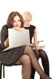 Two women sitting on the chair Royalty Free Stock Photo