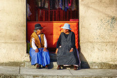 Two Women Sitting In Front Of A Shop in Bolivia Stock Photos