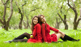 Two women sitting on grass Royalty Free Stock Photo