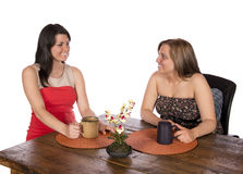 Two women sitting having coffee at table stock photos