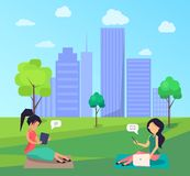 Two Women Sitting on Lawn in Central City Park Royalty Free Stock Photography