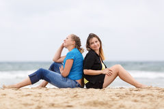Two women sitting Stock Images