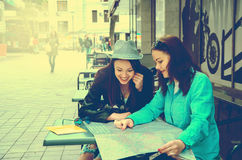 Two women sitting at a table on the street Royalty Free Stock Photography