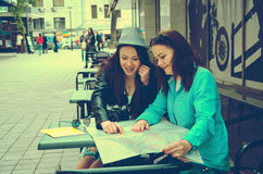Two women sitting at a table on the street Royalty Free Stock Images