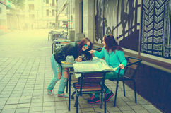 Two women sitting at a table on the street Stock Image