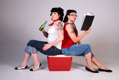 Two women in Sixties fashion. Royalty Free Stock Image