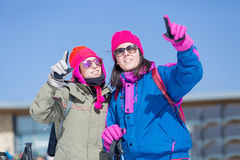 Two women skiers pointing Stock Images
