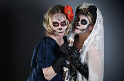 Two women in skull make-up Stock Photography
