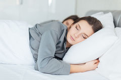 Two women sleeping in bedroom together Royalty Free Stock Image