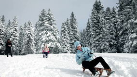 Two women and small girl having winter fun. A family with children while enjoying in the idyllic soroundings stock footage