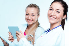 Two women are smiling doctors Royalty Free Stock Image
