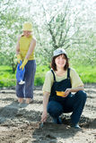 Two  women sows seeds Royalty Free Stock Images