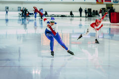 Two women speed skaters compete in distance race Royalty Free Stock Images