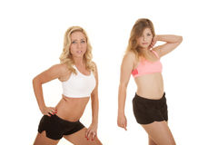 Two women sports bras fitness Stock Images