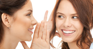 Two women spreading gossip Stock Photos