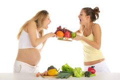 Two women squabbling over fruit Royalty Free Stock Photography