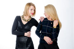 Two women standing in black dresses Stock Photos