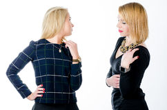 Two women standing in black dresses Royalty Free Stock Photos