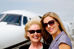 Two women standing outside jet Royalty Free Stock Photo