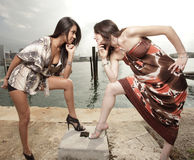 Two women staring at each other. Two beautiful models in a stare-off Royalty Free Stock Photography