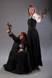 Two women steampunk gun Stock Images