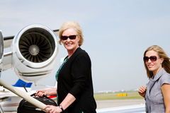 Two women on steps of plane Royalty Free Stock Photos