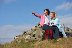 Two Women Stopping For Lunch On Countryside Walk Stock Image