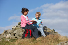 Two Women Stopping For Lunch On Countryside Walk Royalty Free Stock Photos