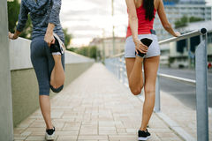 Two women stretching feet Stock Photography