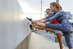 Two women stretching feet Stock Photos