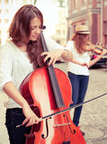 Two women strings duet playing Stock Images