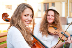 Two women strings duet playing Royalty Free Stock Photo