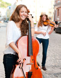 Two women strings duet playing Royalty Free Stock Photography
