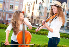 Two women strings duet playing Stock Photo
