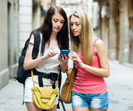 Two women students with bags using the map Stock Photos