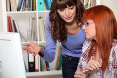 Two women studying together Stock Image