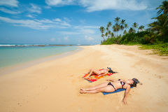 Two women sunbathing Royalty Free Stock Photography