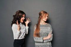 Two women swear Royalty Free Stock Photo