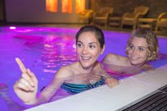 Two women at swimming pool. Two women at the swimming pool Stock Photo