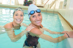Two women in swimming pool. Two women in the swimming pool Stock Photography