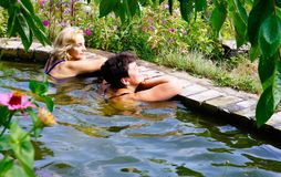 Two women are swimming in the pool. At their summer cottage Stock Image