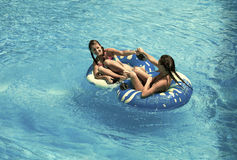 Two women in the swimming pool. Two young women in the swimming pool Royalty Free Stock Image