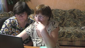 Two women at the table with a notebook stock footage