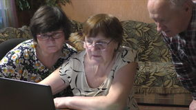 Two women at the table with a notebook. At home stock footage