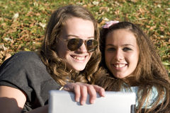 Two women and tablet pc Stock Photo