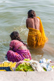 Two women take a bath in the river Ganges Stock Photo