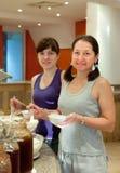 Two women  takes milk  food Royalty Free Stock Photos