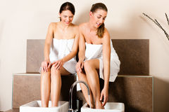 Two women taking a footbath Royalty Free Stock Images