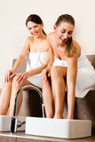 Two women taking a footbath Stock Images